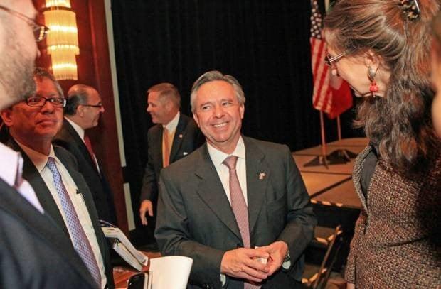 Wayne Trimmer, past chapter president,  and Jose Octavio Tripp, the Consul General De Mexico